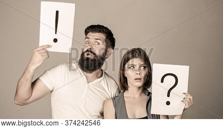 Woman And A Man A Question, Exclamation Point. Couple In Quarrel. Question Mark. Quarrel Between Two