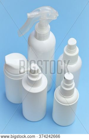 Plastic White Bottles Mockup. Cosmetic Bottles On A Light Blue Background. Beauty And Health Tools C