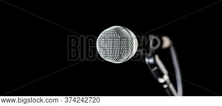 Closeup Microphone. Vocal Audio Mic On A Bleck Background. Audio Equipment. Karaoke Concert, Sing So