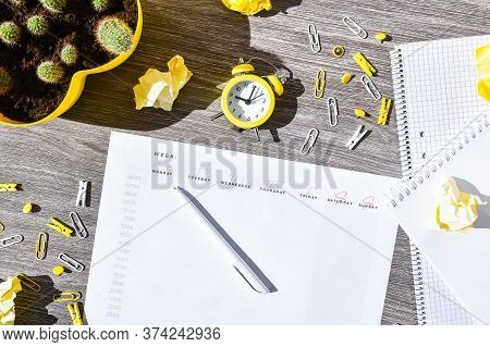 Weekly Planner With Alarm Clock And Office Supplies. Business Planning, Workplace. Paper