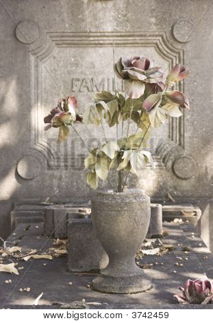 Old Tombstone With Flowers