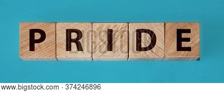 The Text Of The Pride On Wooden Cubes On Aquamarine Blue Background. Lgbt Equal Right Gay Pride Conc