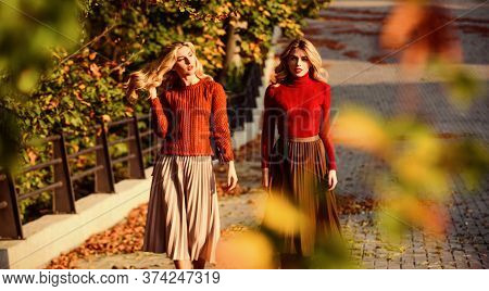 Friends Girls. Fall Fashion. Pleated Skirt Fashion Trend. Women Walking In Autumn Park. Autumn Styli