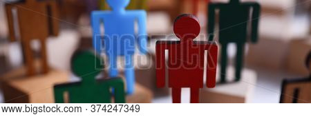 Colored Wooden Figures In Form Man Stand Table. Desire To Perform Tasks That Are Prescribed In Job D