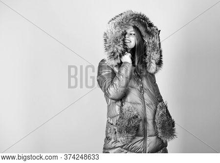 Beauty In Winter Clothing. Cold Season Shopping. Girl In Puffed Coat. Faux Fur Fashion. Happy Winter