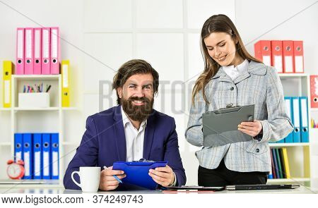 Need Some Help. Successful Partnership And Team Work. Couple On Business Meeting. Signing A Contract