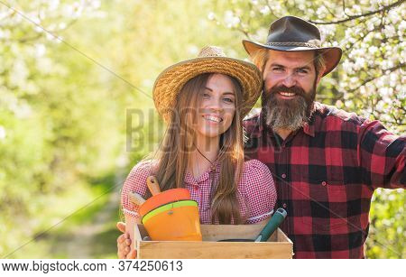 Farming Couple. Happy Couple Hold Gardeners Tools. Family Couple Smile In Spring Garden. Couple In L