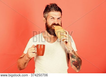 Feel Hunger. Bearded Hipster Enjoy Breakfast Drink Coffee. Morning Tradition Concept. Fresh Baked Cr