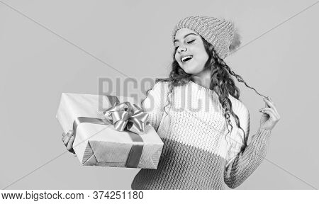 Shopping Center. Happy Little Smiling Girl With Christmas Gift Box. Kid Hold Present Box Yellow Back