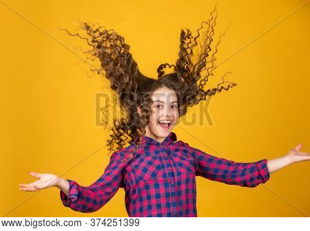 Strong And Healthy Hair Concept. Small Child Long Hair. Kidding Around. Happy Girl With Long Windy H