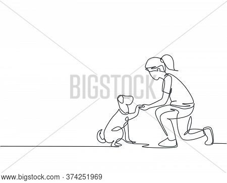 One Line Drawing Of Young Happy Girl Handshaking Her Cute Dog. Friendship About Human And Pet Animal