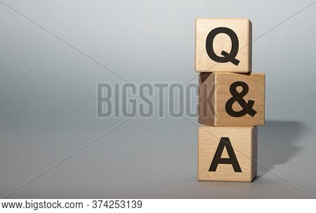 Q And A - Acronym From Wooden Blocks With Letters, Questions And Answers Q And A Concept On Grey Bac