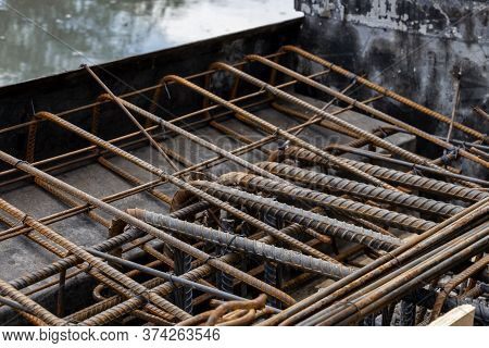 Rebar Tie Wire Work At Construction Site. Steel Bars Reinforcing For Reinforced Concrete And Buildin