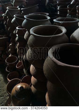 Many clay pots stacked to sell in the market. Indian traditional earthen wares.
