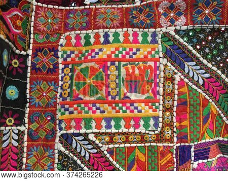 Close up of colorful, hand crafted textile art with elephant motif. Tribal textile art from Rajathan, India.