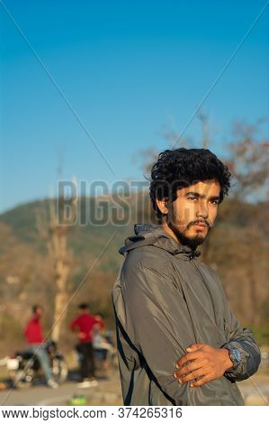 A Handsome Bearded Young Man Getting Mocked By His Friends Standing In The Blurred Background In The