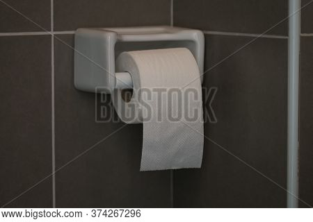 Toilet Paper, White Circular Roll In The Four, Put Beside The Wall In The Bathroom. The Picture Has