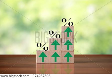 Wooden Cube Block Shapes As Step Stairs With Percent Sign And Green Arrows Pointing Up. Business Con