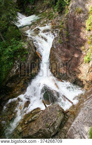 Wodogrzmoty Mickiewicza Waterfall In Tatra Mountains On Roztoka Stream, Poland.