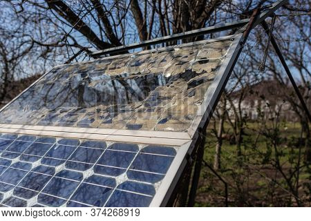 Broken Small Solar Panel Photovoltaic Electric System For Home In The Village. Alternative Energy Co