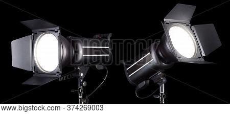 Set Of Photography Studio Flash Isolated On Black Background With Lamp.