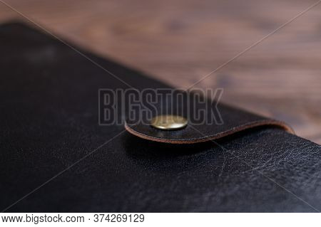 A Part Of Black Gloss Formal Daily Planner On Old Wooden Background. Branding Mockup.