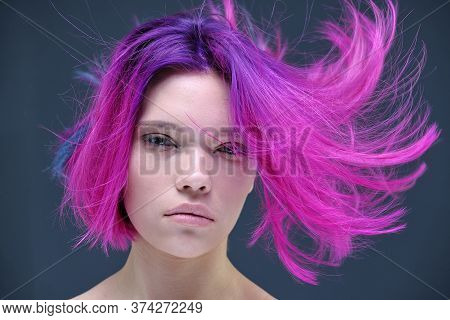 Concept Portrait Of A Punk Girl, Young Woman With Chic Purple Hair Color In Studio Close Up On A Col