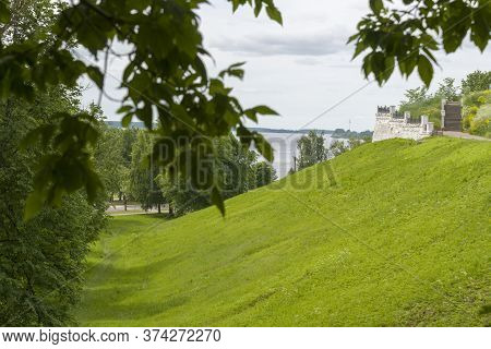 Green Hills Overlooking The River In The Summer.