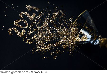 New Years And Christmas. Numbers 2021 From Spangles Scattered From A Shiny Glass On A Black Backgrou