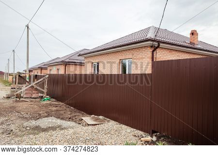 Brick House Wall Facade. Construction Of Houses. Cottage Red Brick House