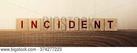 Word Incident On Wooden Blocks On Wooden Table. Insurance Business Concept