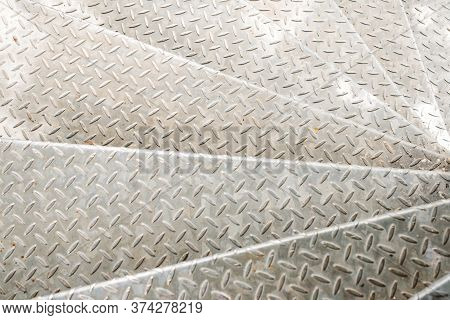 Non-slip Steel Stairs. Metal Textured Surface. Metallic Checker Plate Anti-slip Texture Background.