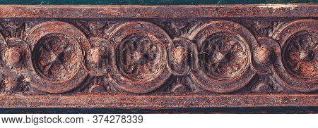 Old Patterns On A Wooden Door. Wooden Carving Gate. Vintage Textures And Details On Doorway. Woodcar