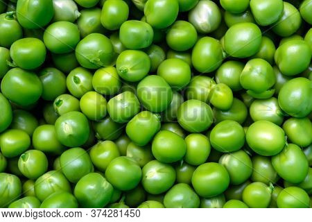 Background Of Fresh, Young, Peeled Green Peas