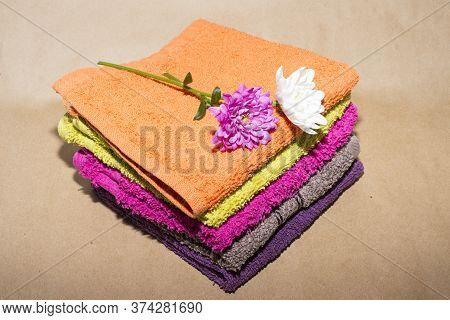 Some Facecloths Off Various Shades With Flowers