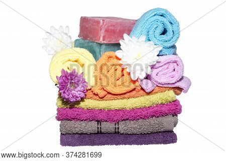 Soap Bars On Facecloths Off Various Shades With Some In Rolls And Flowers