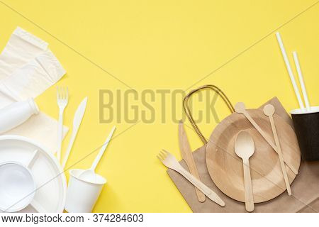 Plastic And Wooden Utensils On Yellow Background. Choosing Eco-friendly Utensils. Concept: Conservat