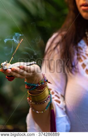 Aromatic Incense For A Favorable Atmosphere, Meditation Sticks, Incense Stand In Woman's Hand