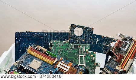 Colored Heap Of Electronic, Plastic And Metal Parts From Old Discarded Or Obsolete Pc Components. Ec