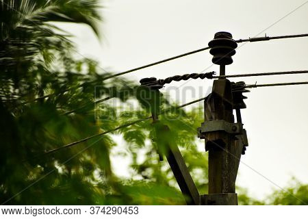 Electricity Pole Or Electricity Post. Top Of Electric Post. Electric Wire Lines Connecting To The Po