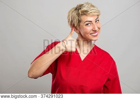 Portrait Of Young Attractive Female Nurse Showing Like Gesture