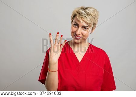 Portrait Of Young Attractive Female Nurse Showing Number Four