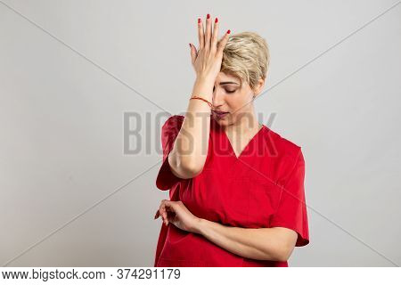 Portrait Of Young Attractive Female Nurse Making Mistake Gesture