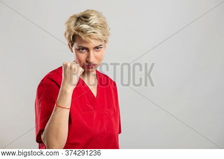 Portrait Of Young Attractive Female Nurse Showing Fist Like Fighting