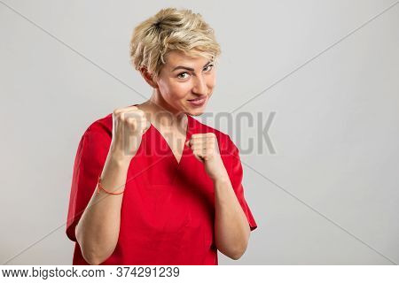 Portrait Of Young Attractive Female Nurse Showing Fists Like Fighting