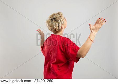 Portrait Of Young Attractive Female Nurse Making Winner Gesture