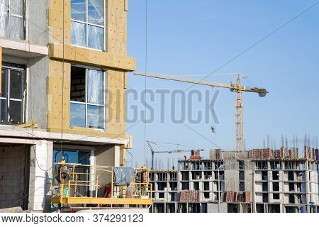 Suspended Cradle Mobile Scaffolding Platform For Construction Work At Height. Mineral Wool For Insul