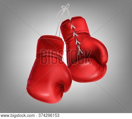 Realistic Red Pair Of Leather Boxing Gloves Hanging On Laces. Protective Sport Equipment In Fist Fig