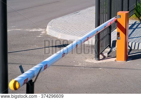 Concrete Road Barriers And A Pneumatic Barrier In Orange Color With A White Stripe And Red Warning S