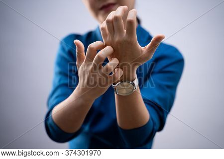 Woman Was Sick With Irritate Itching Her Skin, Scratching Her Skin, Standing Isolated On Background.